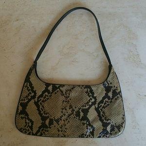 Snakeskin print, small leather bag.